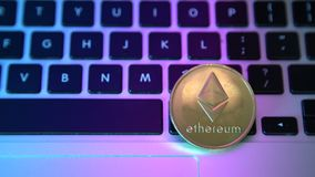 Circle Ethereum coin on top of computer keyboard buttons. Digital currency, block chain market, online business.  stock video