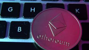 Circle Ethereum coin on top of computer keyboard buttons. Digital currency, block chain market, online business.  stock video footage