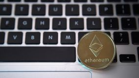 Circle Ethereum coin on top of computer keyboard buttons. Digital currency, block chain market, online business