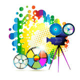 Circle film frames. With camera over colorful background Royalty Free Stock Image