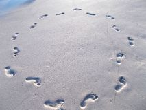 Circle of footprints in beach sand Stock Image