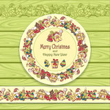 Circle frame and border from Christmas  elements on Light green wood background Royalty Free Stock Photos