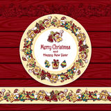 Circle frame and border from Christmas  elements on red wood background Stock Photo