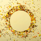 Circle frame made of sugar candies, pastry decoration on yellow background. stock images
