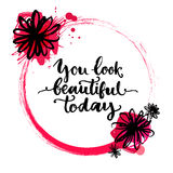 Circle frame with rough brush stroke, ink flowers. And paint splashes. Inspirational quote - you look beautiful today. Vector hand lettering, brush script Royalty Free Stock Photos