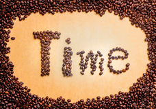The circle frame of wording time. Coffee beans and brown vintage background Royalty Free Stock Image