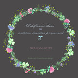 Circle frame, wreath of the yellow wildflowers, clover flowers and grass, hand drawn in a watercolor on a dark background Royalty Free Stock Image