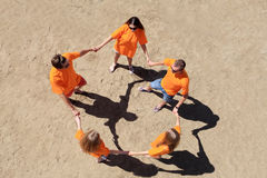 Circle of friends. Cheerful young people having fun on a beach. Great summer holidays Royalty Free Stock Images