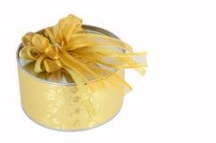 Circle gold gift box. On white background Stock Image