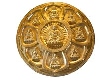 The circle of golden buddha. On the wall with Isolated on White Royalty Free Stock Image
