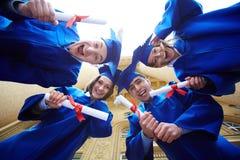 Circle of graduates Royalty Free Stock Photos