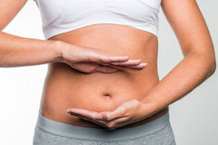 Circle of hands on stomach. Circle of hands on young woman's stomach Royalty Free Stock Photography