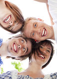 Circle of happy friends with their heads together Stock Photos