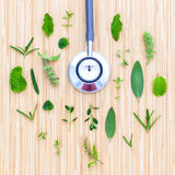 The circle of Herbs leaf and flower with stethoscope on wooden t Royalty Free Stock Photography