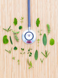 The circle of Herbs leaf and flower with stethoscope on wooden t Stock Image