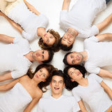 Circle of hilarious friends Stock Images