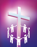 Circle holding hands around cross Stock Photography