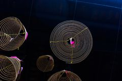 Circle of the incense sticks. The beautiful circles of the incense sticks in a pagoda of Vietnam Stock Photo
