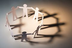 Joined of big team cooperate. Circle joining of paper figure on light background. in concept of business, cooperation and teamwork royalty free stock photography