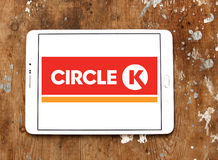 Circle K stores logo. Logo of the international chain of convenience stores Circle K on samsung tablet on wooden background Stock Photography