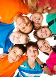 Circle of kids looking down. 7 kids looking down standing in a circle smiling and looking down Royalty Free Stock Photo