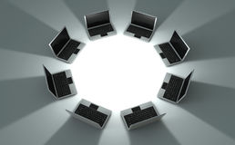 Circle of laptops. 3d rendered image of a perspective view circle of eight laptops with shadow Stock Images