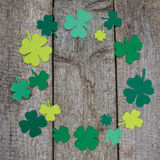 Circle of leaf clover made of felt on table. Patricks Day Stock Photos