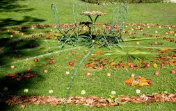 Circle of leaves with apples and coffee table in the garden of the castle in the village of Strassoldo Friuli (Italy) Stock Photos