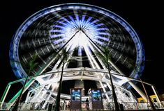 The circle of light. The ferris wheel is the symbol of amusement park Stock Photos