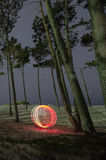 Circle of light. Light Painting with trees and night sky Stock Photography