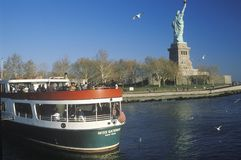 Circle Line Boat at the Statue of Liberty, New York City, New York Royalty Free Stock Photography