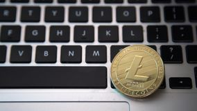 Circle Litecoin, lite coin on top of computer keyboard buttons. Digital currency, block chain market, online business