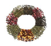 Circle made of different types of dry tea leaves on white background royalty free stock image