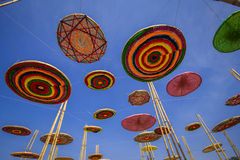 Circle made of silk, a variety of colors, in the midst of the sky. Stock Photos