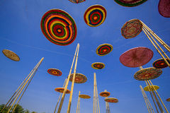 Circle made of silk, a variety of colors, in the midst of the sky. Stock Images