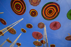 Circle made of silk, a variety of colors, in the midst of the sky. Stock Image