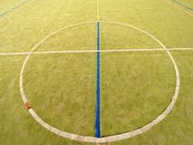 Circle in middle of court. Empty outdoor handball playground, plastic light green surface Stock Image