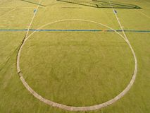 Circle in middle of court. Empty outdoor handball playground, plastic light green surface Stock Photo