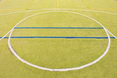 Circle in middle of playground. Empty outdoor handball  court Stock Image