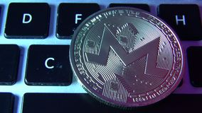 Circle Monerd coin on top of computer keyboard buttons. Digital currency, block chain market, online business