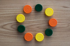 Circle of multicolored plastic closures Stock Photography
