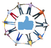 Circle of Multiethnic People Thumbs Up Symbol Stock Images