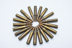 Circle of old rifle cartridges 5.56 mm on a white background Stock Images