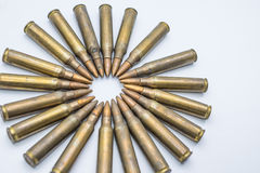 Circle of old rifle cartridges 5.56 mm on a white background Royalty Free Stock Photo