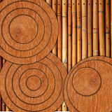 Circle old wood on old bamboo Stock Photography