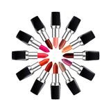 Circle of open tube of lipstick. Lipstick of different colors laid out in a circle. Isolated on white. Royalty Free Stock Photo