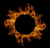 Circle of orange flame isolated on black Stock Photography