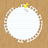 Circle pad. With yellow pin on wooden backgrounds Royalty Free Stock Image