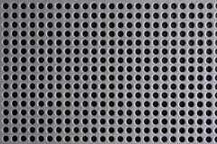 Circle pattern. Closeup of the grill of a stereo speaker stock image