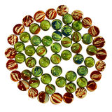 Circle pattern of colorful transparent glass marbles isolated on Royalty Free Stock Photography